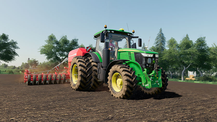 A modified John Deere 7R is planting seeds, using a Horsch seeder