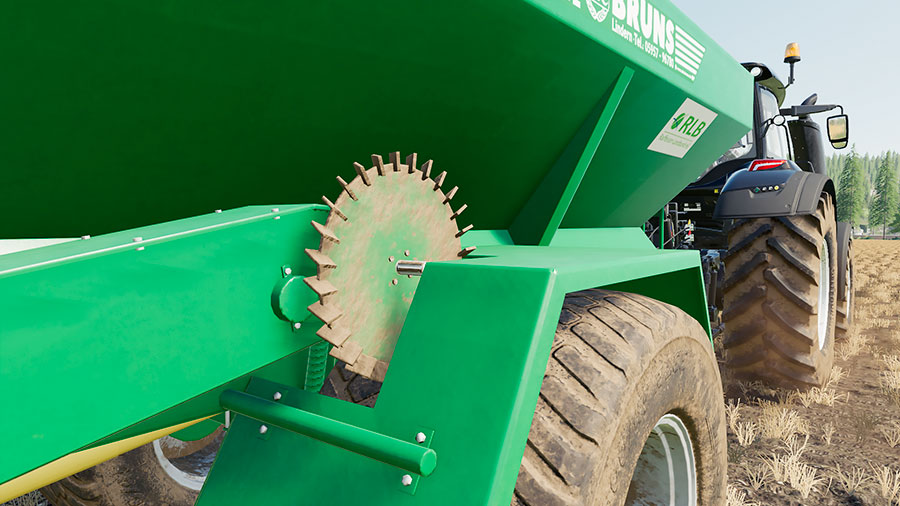 Close up of the steering wheel that runs the conveyor inside the Bruns spreader