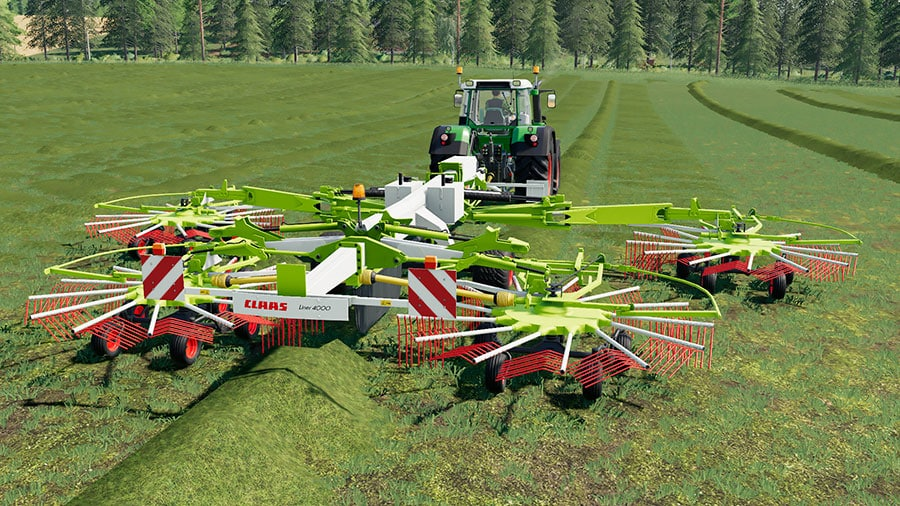 The Claas Liner 4000 windrower creating swaths in a field, pulled by a Fendt tractor