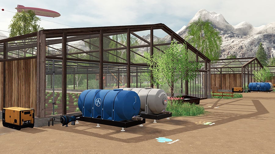 A collection of greenhouse with water tanks in front