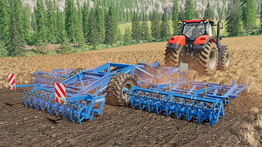 The Köckerling Allrounder Profiliner 850 from the rear, cultivating a field