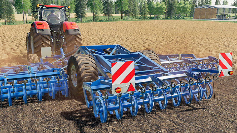 The Köckerling Allrounder Profiliner 850 pulled by a tractor