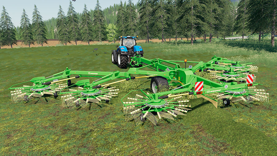 The Krone Swadro 2000 raking grass, creating swaths, pulled by a New Holland tractor
