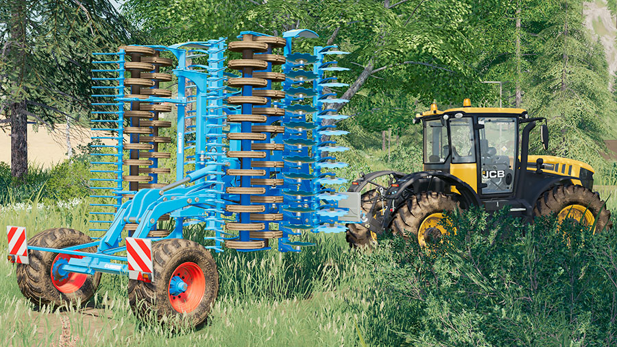The Lemken Heliodor 9/600 in transport mode (folded) pulled by a JCB tractor