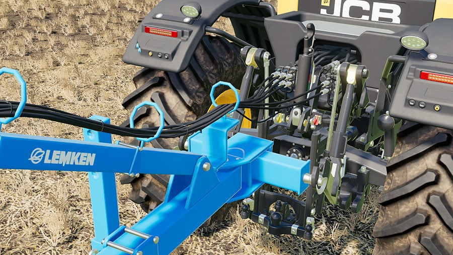 A close up showing the connection hoses of the Lemken Heliodor 9/600