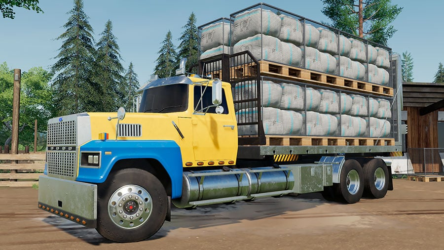 A Ford LTL 9000 truck is carrying wool pallets on a swap body flatbed
