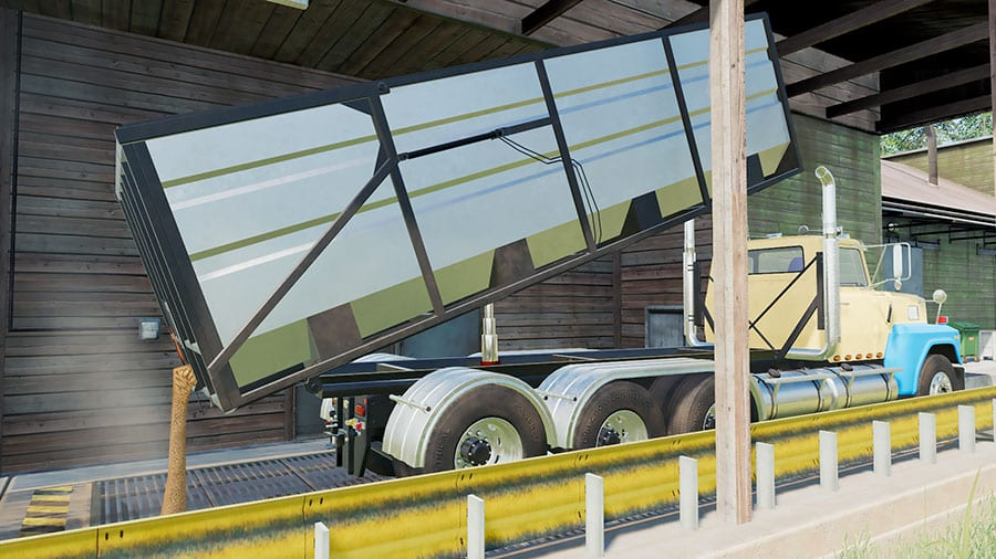 A Ford LTL9000 swap body truck unloads grain from the interchangeable dump box