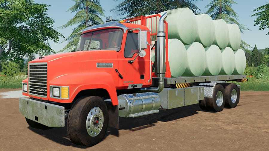A Mack Pinnacle transporting round bales on a swap body flat bed with Autoload