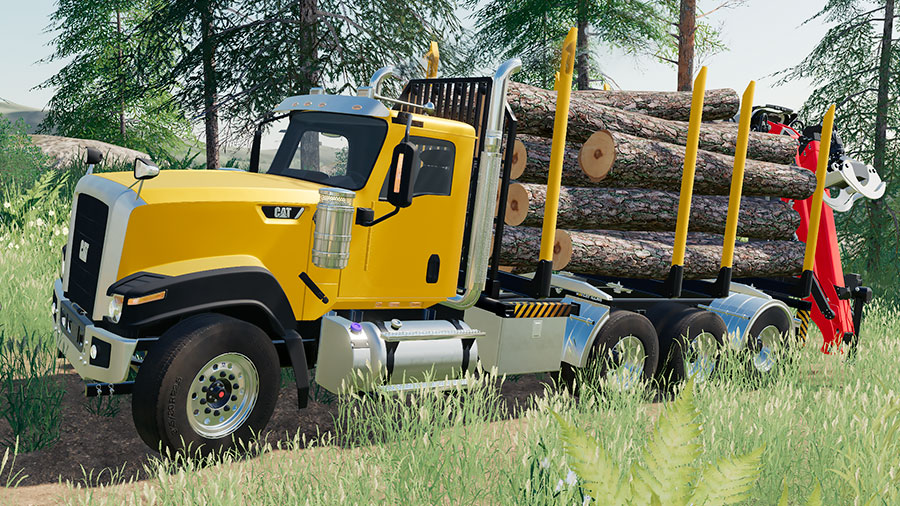 A Cat CT680 truck transporting logs on a swap body log bed