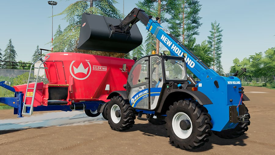 A New Holland LM 7.42 unloading silage into a TMR mixer trailer