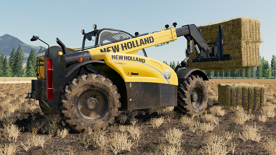 A New Holland TH 7.42 stacking straw bales in a field