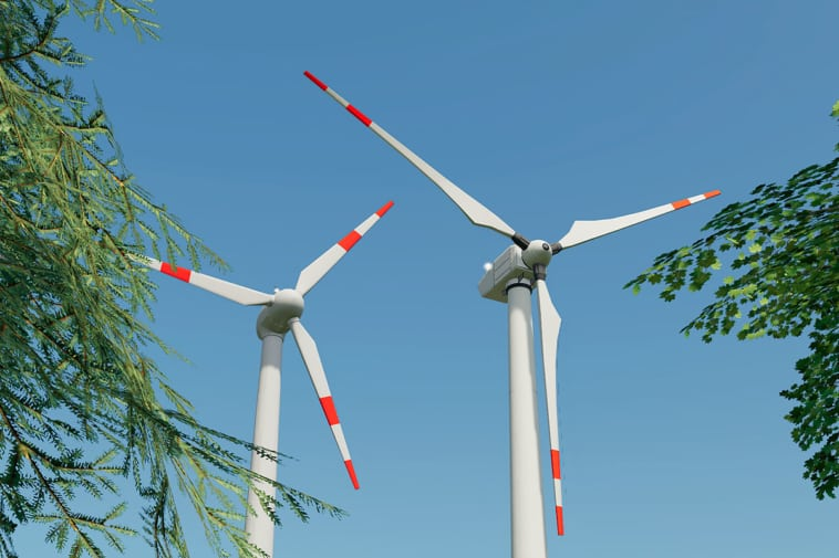 Two wind turbines placed close to each other.