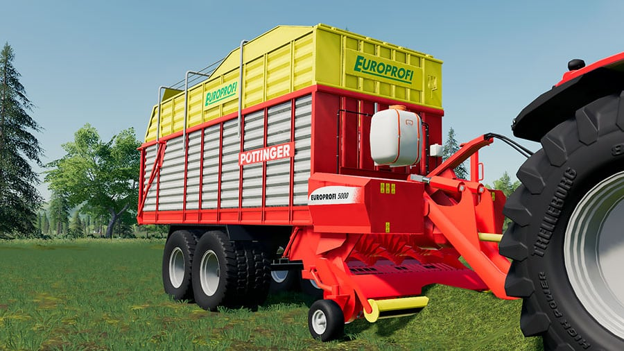 The Pöttinger EuroProfi 5000 picking up grass in a field
