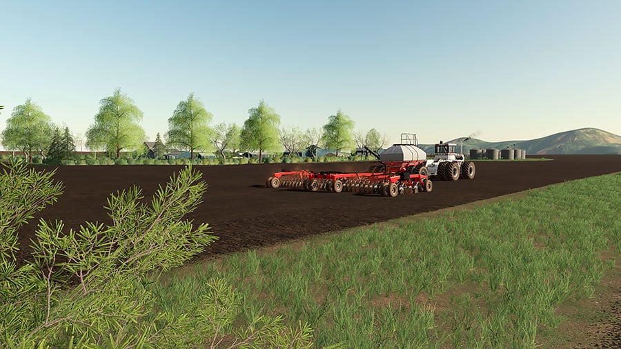 A Big Bud tractor sowing in a field on the Welker Farms map